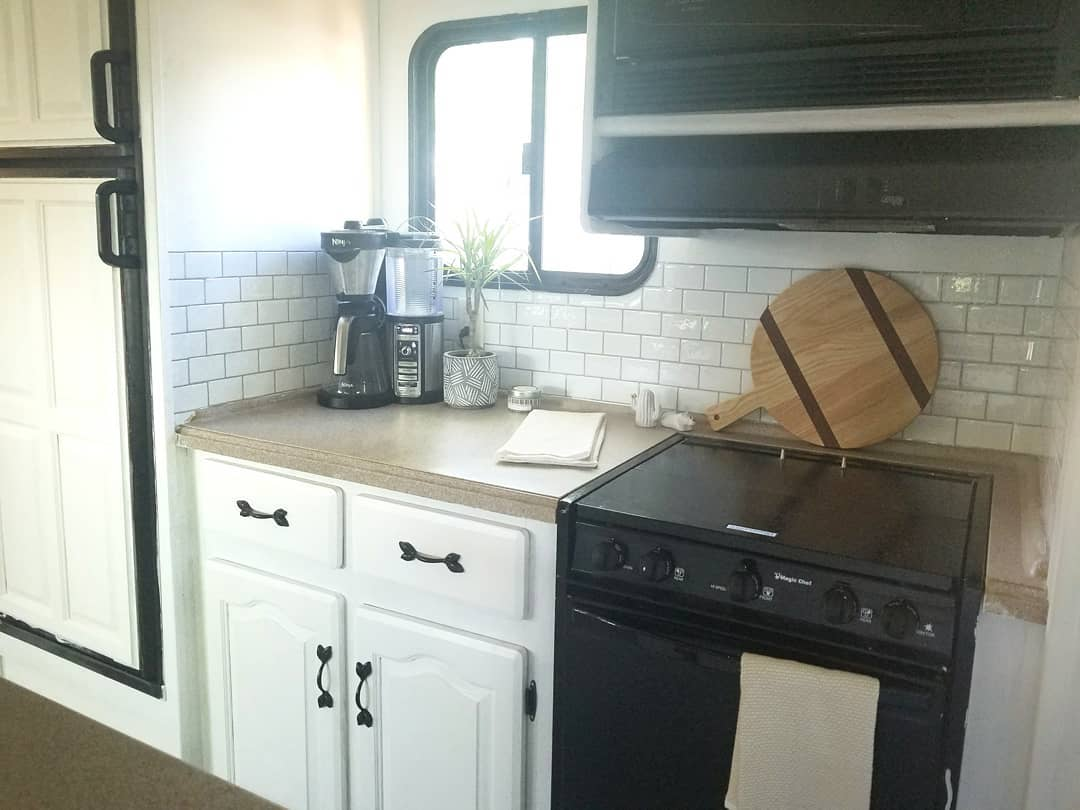 You need to see this lovely renovated 5th wheel, full-time home to a family of four and a fur baby. #RVremodel #rvrestoration #camper remodel